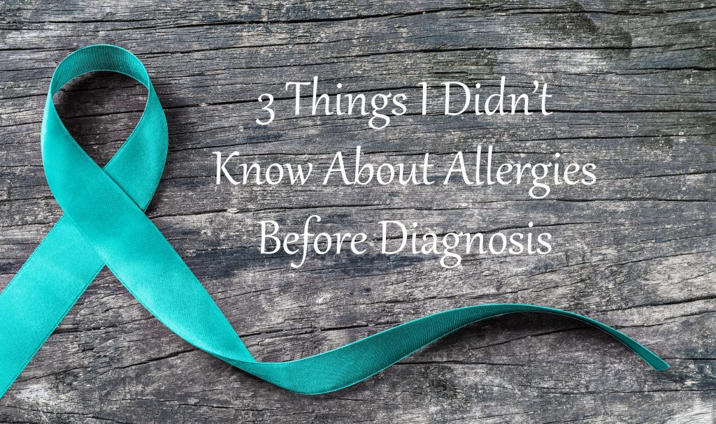"""Teal ribbon on a gray, wooden background with the words """"3 Things I Didn't Know About Allergies Before Diagnosis"""